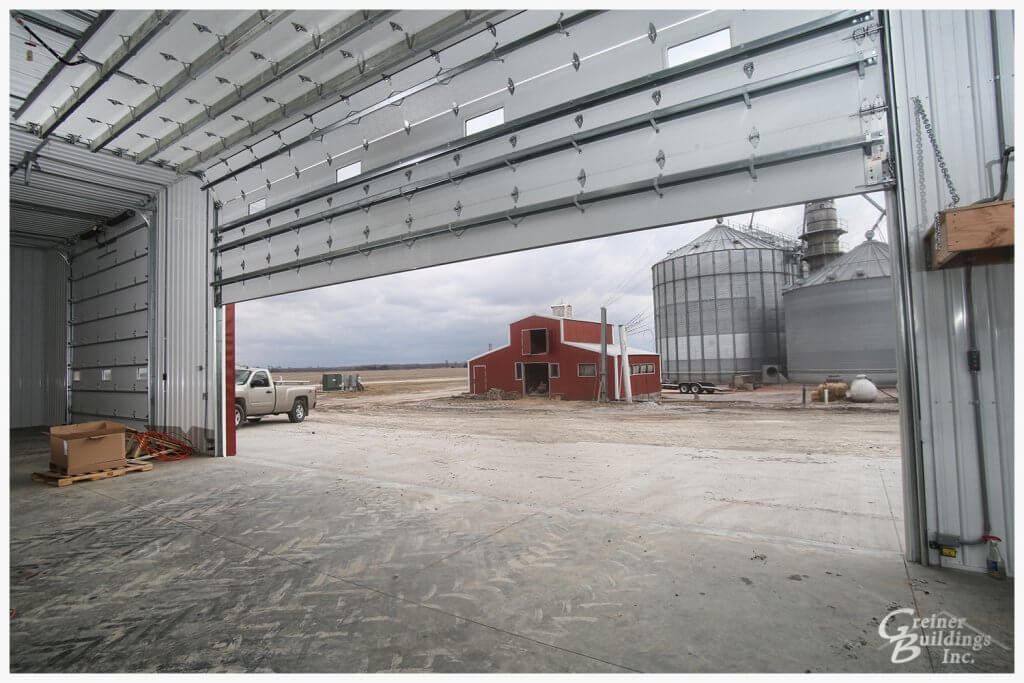 Large overhead doors in the post frame pole barn machine shed